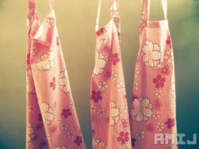 aprons-hanging-with-logo.jpg